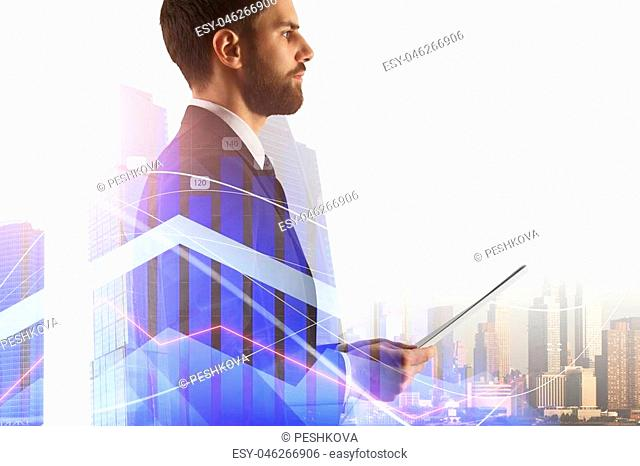 Banking and investment concept with double exposure of young businessman holding financial document at megapolis city background and financial chart