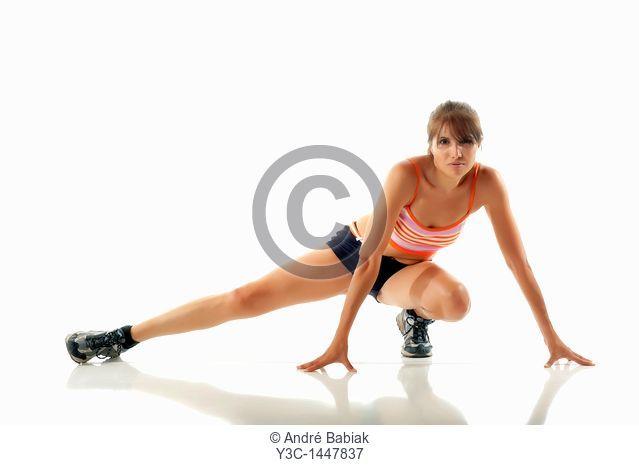 Hispanic fitness woman stretching