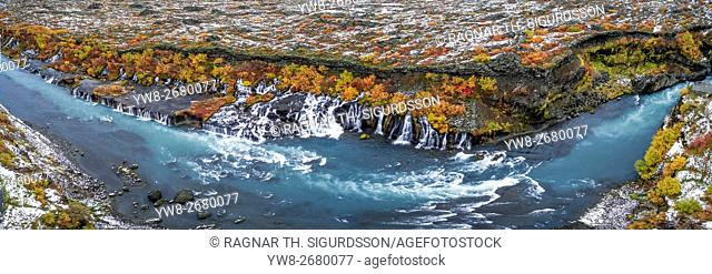 Hraunfossar waterfalls in the autumn, Borgafjordur, Iceland. This image is shot using a drone