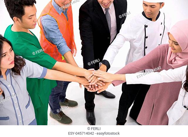 Set of people with different job putting their hands on top of each other