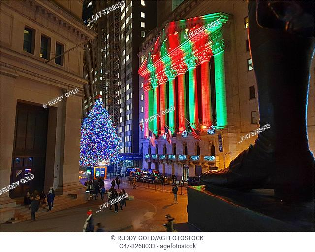 The New York Stock Exchange at Christmas time with George Washington monument foot in foreground. Wall Street. New York. USA