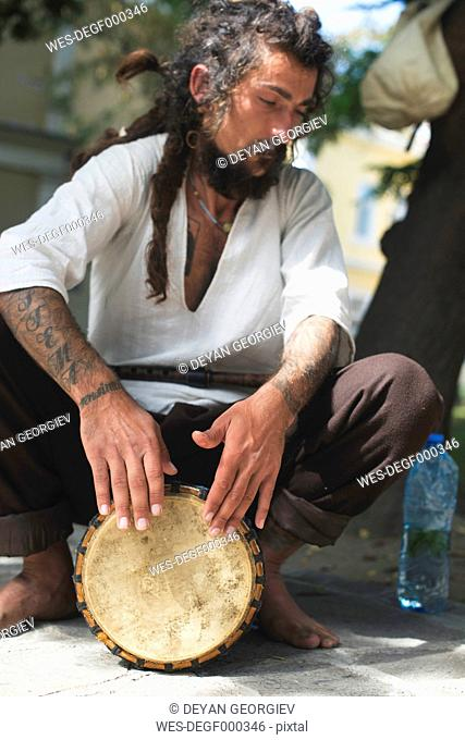 Street musician playing drum