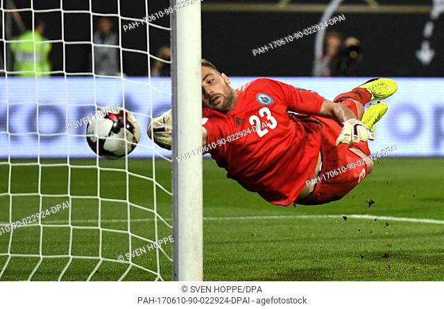 Goalie Elia Benedettini of San Marino is unable to stop Mustafi of Germany's goal for 5:0 during the World Cup qualifier Group C soccer match between Germany...