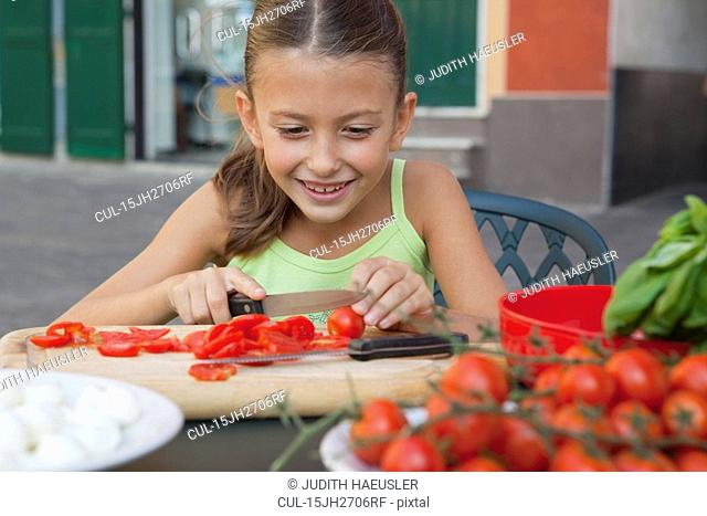 girl cutting tomatoes
