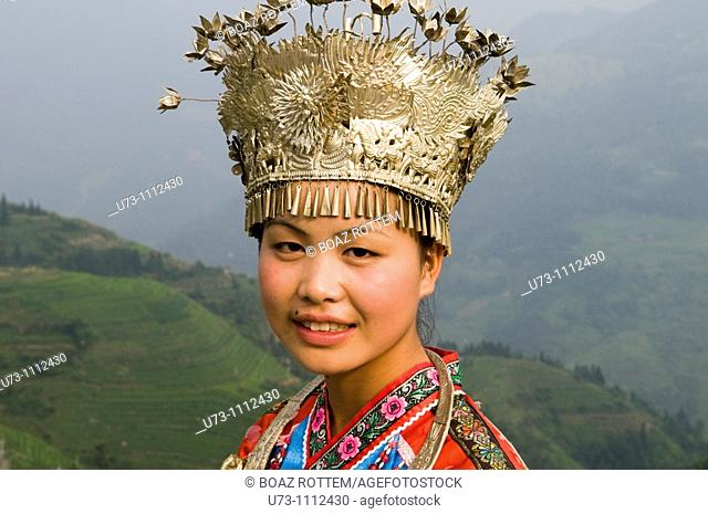 Portrait of a Miao girl wearing her traditional festivity clothing