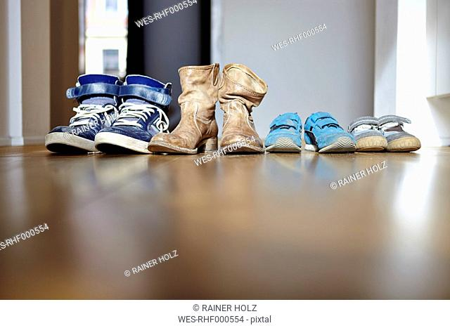 Row of shoes of a family