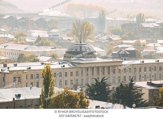 Gori, Shida Kartli Region, Georgia. Gori City Hall On Stalin Square In Autumn Misty Morning. Travel Destination