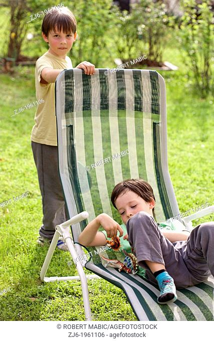 Boys playing outdoor in the garden