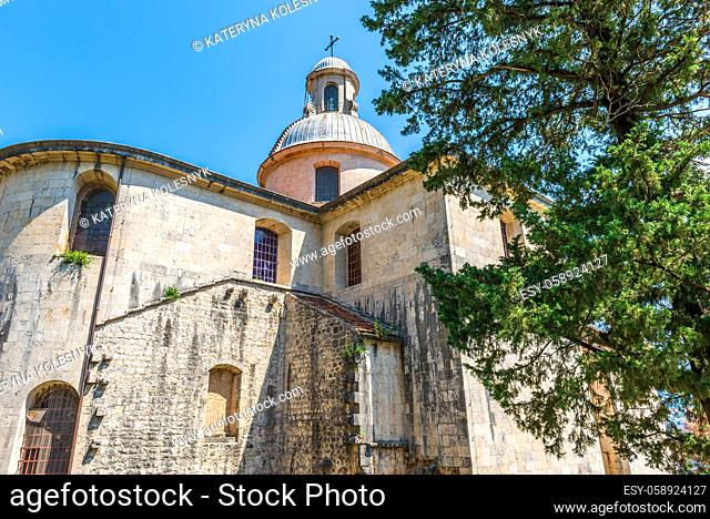 Old church in Prcanj and blue sky at summer day, Montenegro