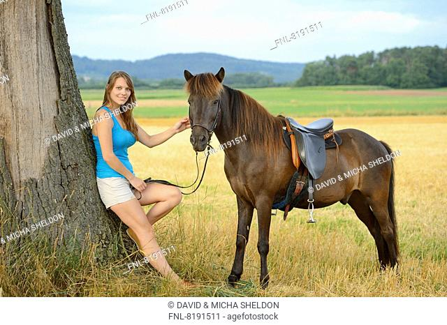 Young woman with an icelandic horse, Franconia, Bavaria, Germany, Europe