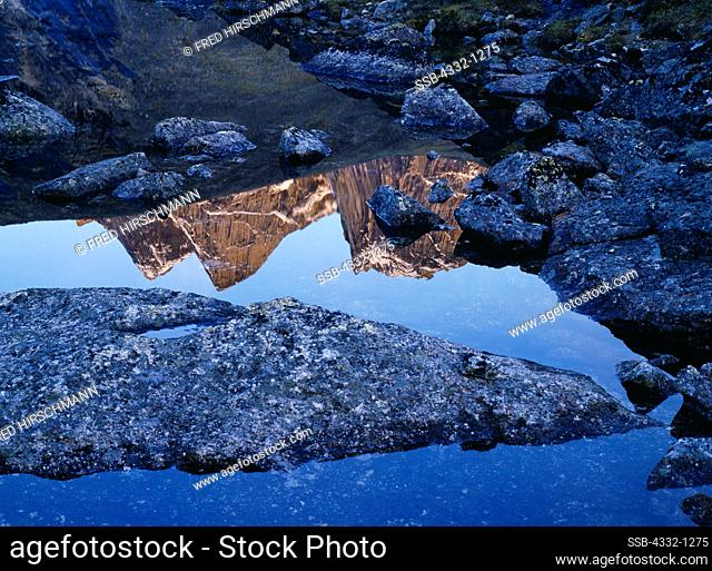 Arrigetch peaks reflected in alpine lake, Gates of the Arctic National Park, Brooks Range, Alaska