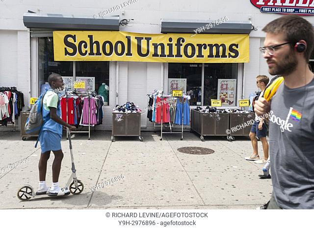 A store in Harlem in New York promotes school uniforms as part of its back-to-school shopping offerings on Sunday, August 6, 2017 (© Richard B