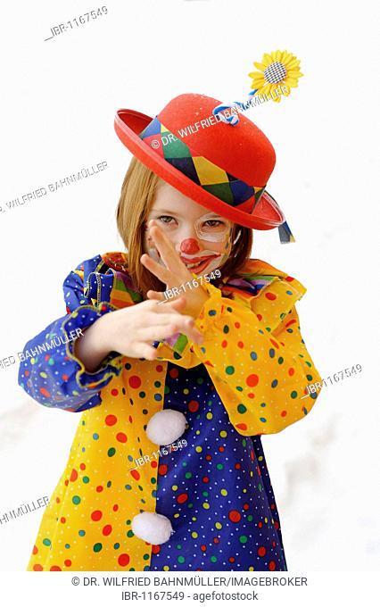 Clown girl in carnival costume