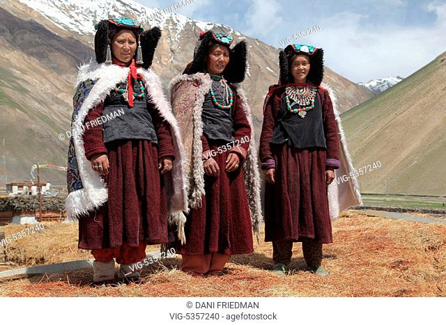 INDIA, RANGDUM, 27.06.2014, Ladakhi women dressed in traditional outfits and wearing perak headdresses in a small village in Rangdum, Ladakh, Jammu and Kashmir