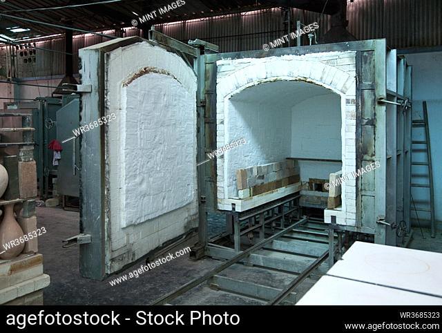Clay oven with open door in pottery