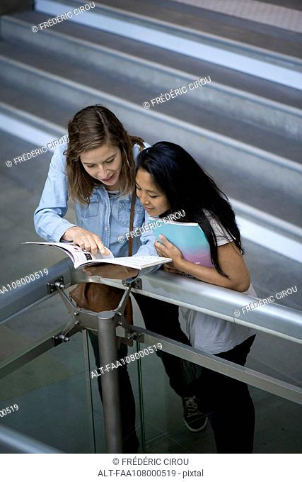 Woman looking at book together