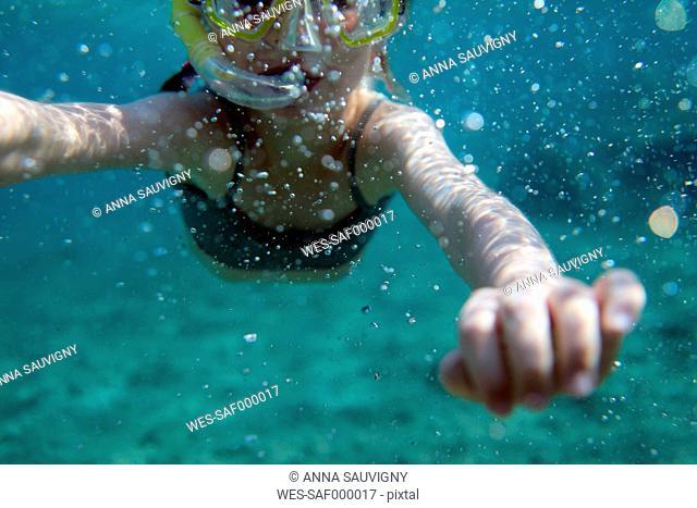 Europe, Girl snorkeling in sea