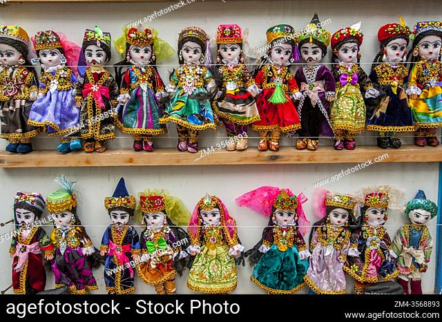 A bazaar scene (a market in a Middle Eastern country) with souvenir dolls in Bukhara, Uzbekistan