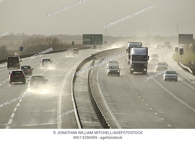 UK Bedfordshire -- 12 Feb 2014 -- Hazardous conditions on the busy A421 near Bedford England UK this afternoon as high winds from a large Atlantic storm caused...