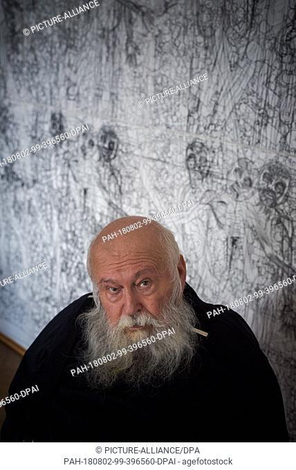 01 August 2018, Austria, Prinzendorf an der Zaya: The Austrian painter and action artist Hermann Nitsch sits in front of one of his works at Prinzendorf Castle