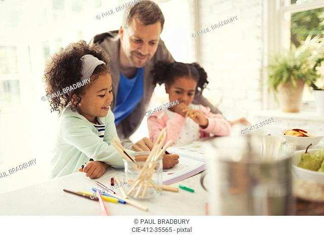 Multi-ethnic father and daughters coloring