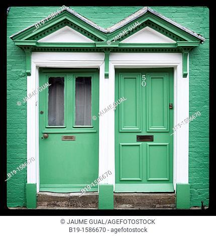 Two gren doors in a green wall, Arundel, England, Europe