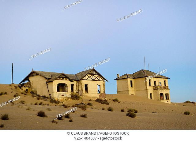 Two buildings in ghost town Kolmanskop  Near Lüderitz, Namibia
