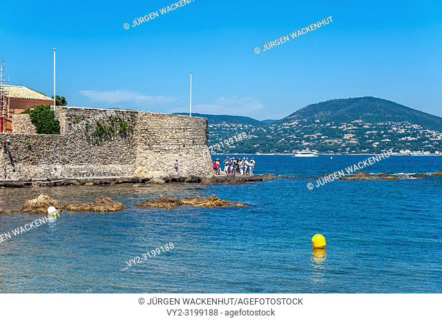 Historic city wall and the Old Tower at the old fishing harbor, Saint-Tropez, Var, Provence-Alpes-Cote d`Azur, France, Europe