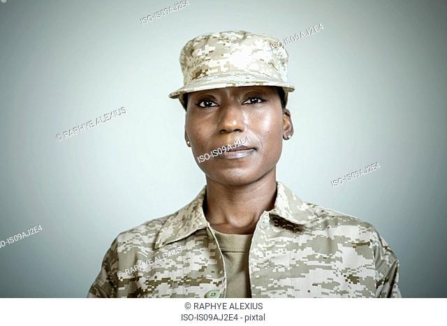Studio portrait of confident female soldier