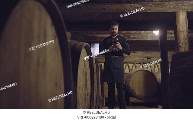 Farmer checking on wine