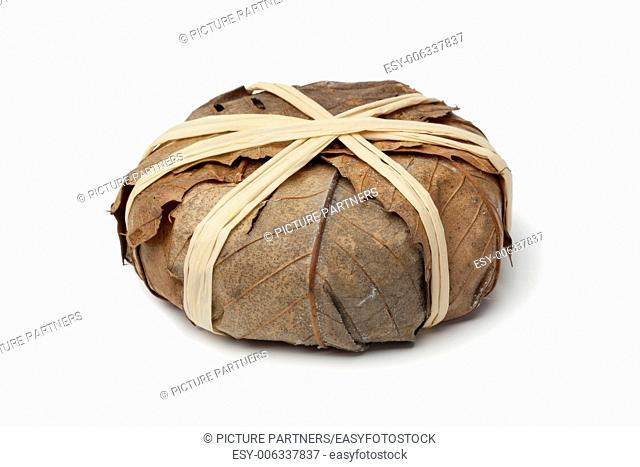 French Banon cheese in chestnut leaves on white background