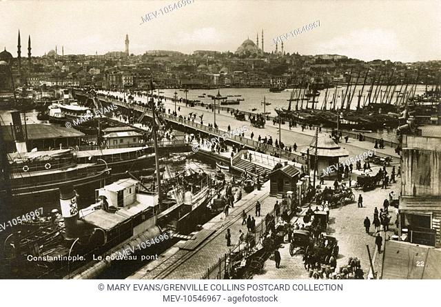 Galata Bridge, Istanbul, Turkey - with view across Golden Horn toward the Yeni Cami (New Mosque) (back left) and the Suleymaniye Cami (back centre)