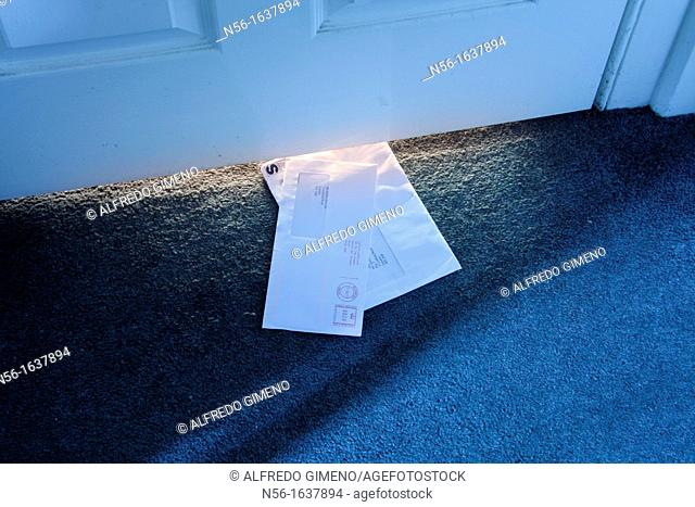 mail under the door