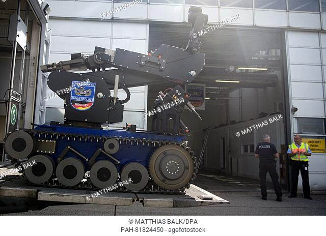 A radio control manipulator of the defusors of the federal police drives out of a special vehical of the police at the airport in Munich, Germany, 4 July 2016