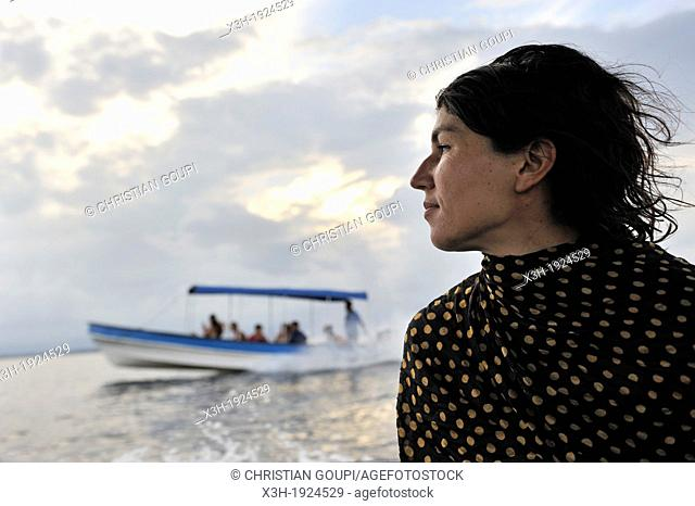 young woman on a boat trip around Colon Island, Bocas del Toro Archipelago, Republic of Panama, Central America