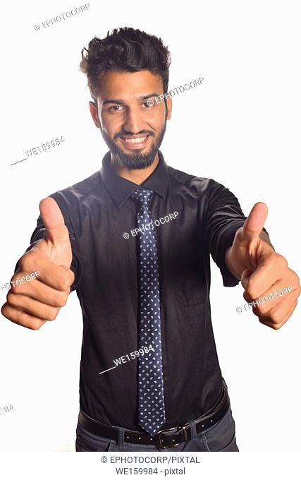 Young male model saying OK with thumbs, Pune, Maharashtra
