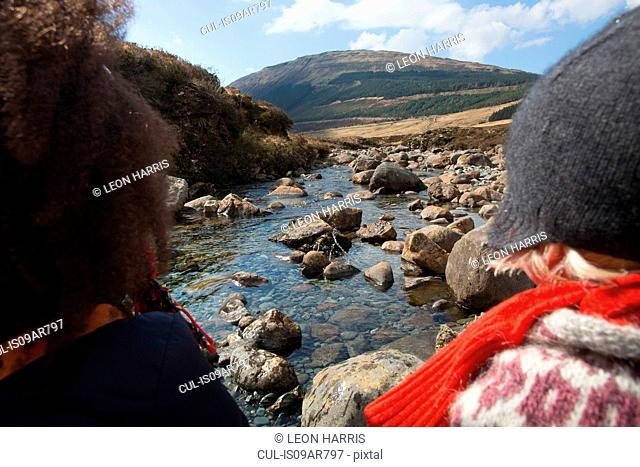Woman and boy looking at view, Fairy Pools, Isle of Skye, Hebrides, Scotland