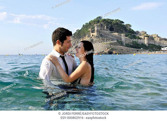 Young couple on the beach, Tossa de Mar, Costa Brava, Girona, Spain, Europe