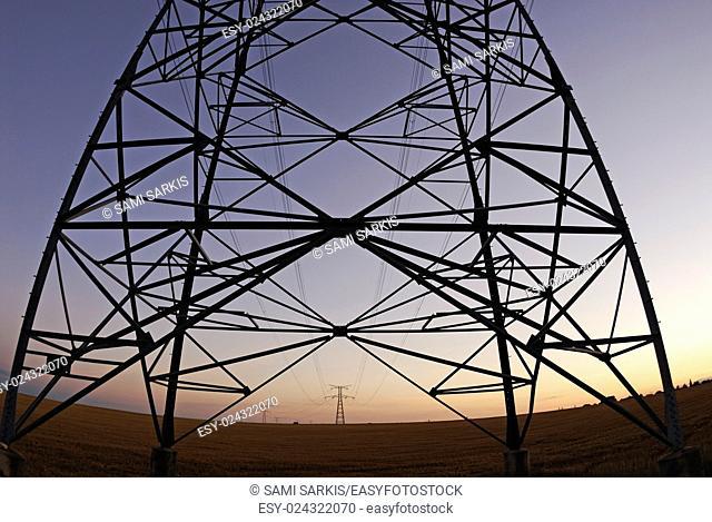 Electricity pylons at sunset, Lion en Beauce, France (fisheye lens)