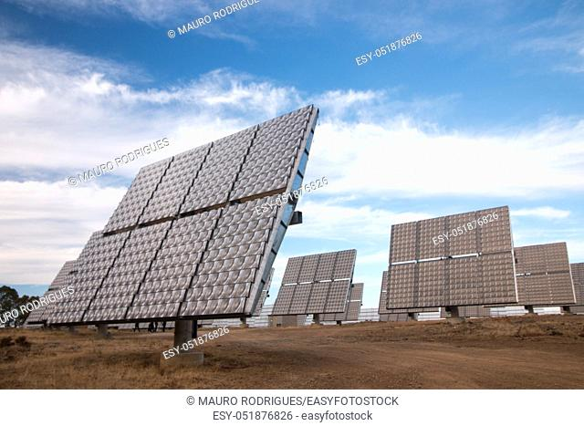 View of a field of photovoltaic solar panels gathering energy on the countryside