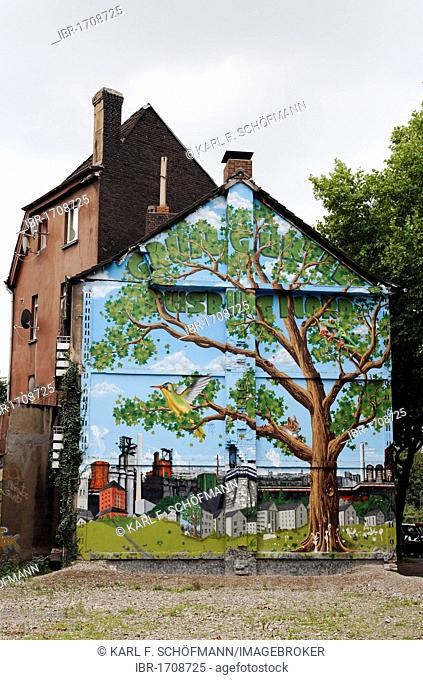 Old house about to be demolished, wall painted with a tree in an industrial landscape, Bruckhausen district, Duisburg, North Rhine-Westphalia, Germany, Europe