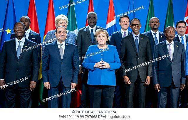 19 November 2019, Berlin: Chancellor Angela Merkel (M, CDU) together with (l-r) Alassane Ouattara, President of the Ivory Coast, Ramuald Wadagni