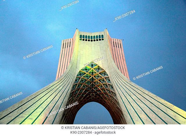 Dark clouds above the top of the Azadi Tower, Borj-e Azadi, Tehran, Iran, Asia