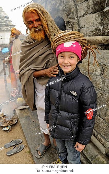 Sadhu with Rasta locks, Asket with child, Pashupatinath, Kathmandu Valley, Nepal
