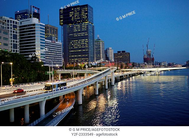 Traffic on Pacific Motorway and Brisbane city skyline by the river, Australia