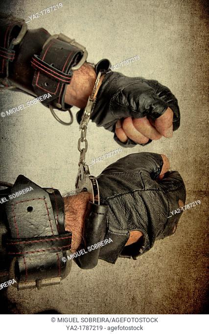 Gloved Hands in Cuffs