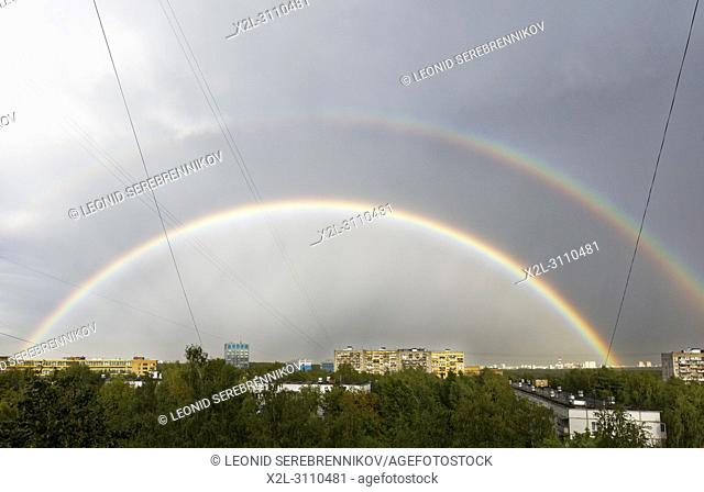Double rainbow in the sky after summer rain storm on August 7, 2018. Moscow, Russia