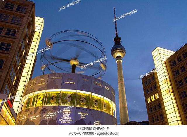 The Weltzeituhr, Worldtime Clock and the Fernsehturm or Berlin TV Tower at Alexanderplatz in Berlin, Germany