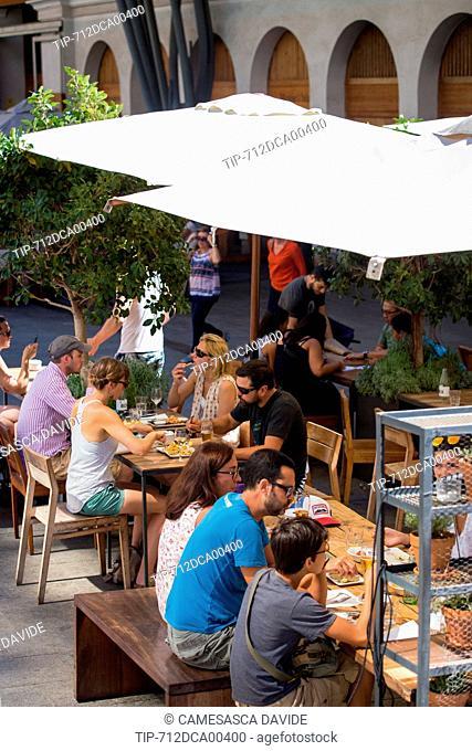 Spain, Catalonia, Barcelona, Santa Caterina market, People having lunch outside the Santa Caterina market