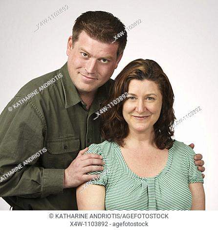 Loving married heterosexual couple posing for portrait